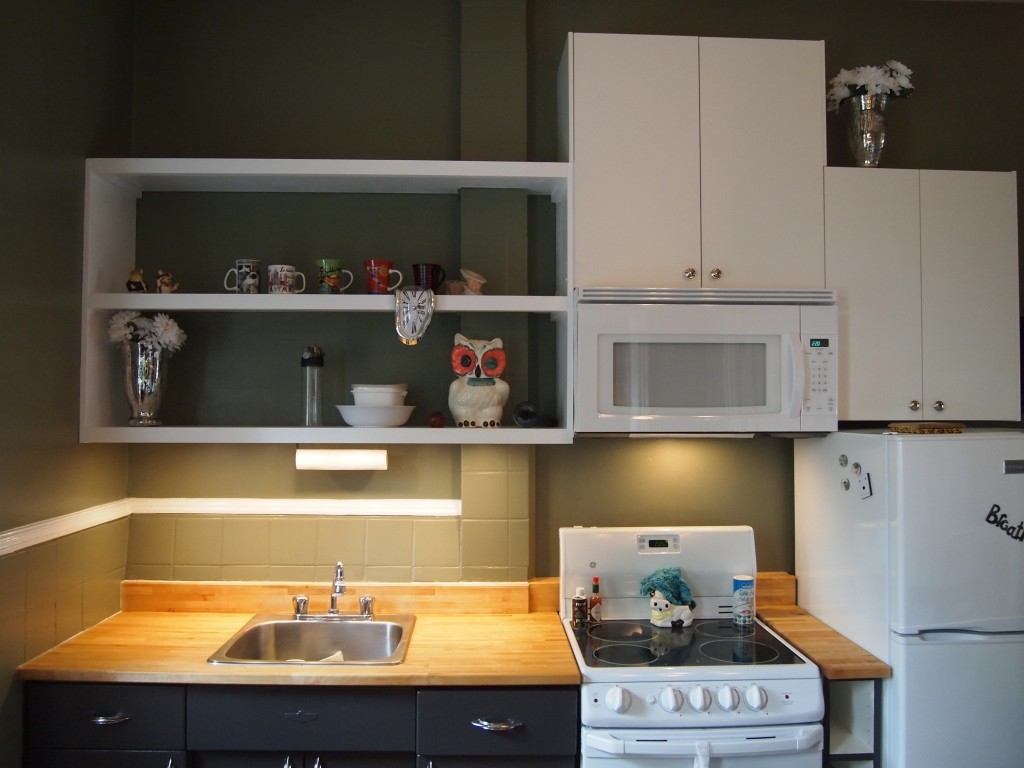 After: shelves and cabinetry allow clutter to be removed from workspaces; under-shelf lighting brightens the space.